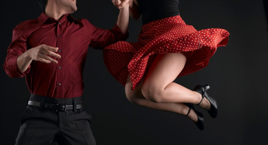 Happy couple dancing energetically during a dance class display
